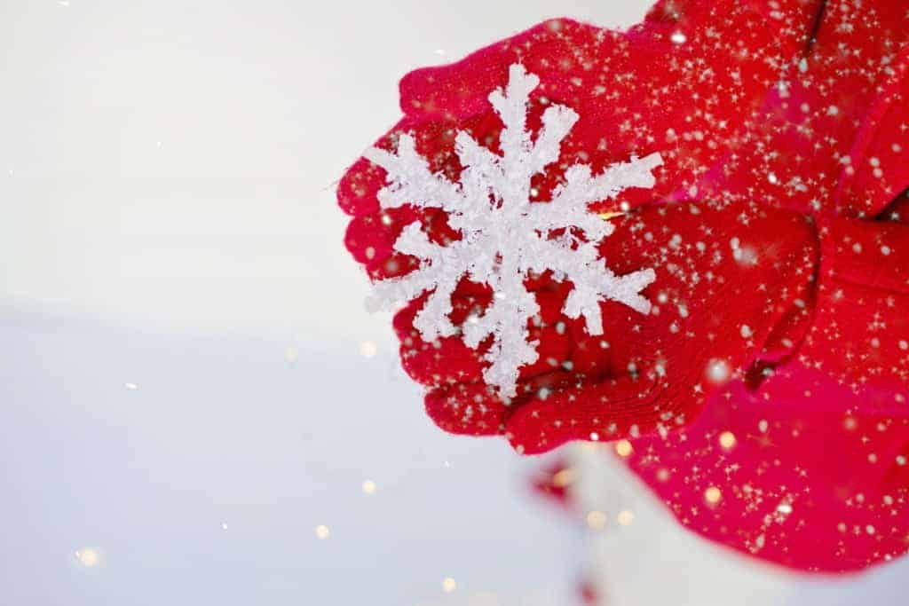 Red Gloved Hands holding a LARGE snowflake