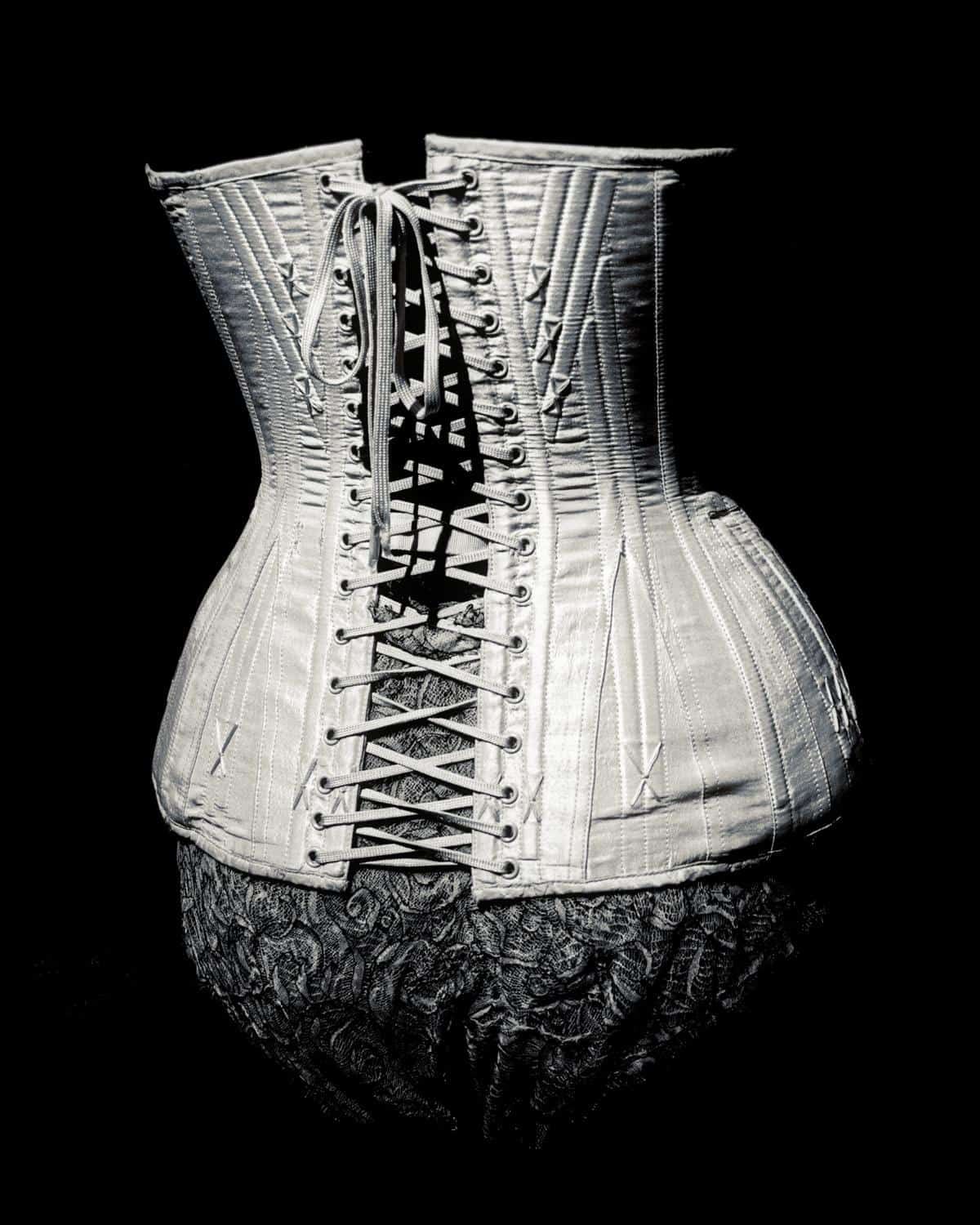 Black and White image of a corset designed by Jean Paul Gaultier