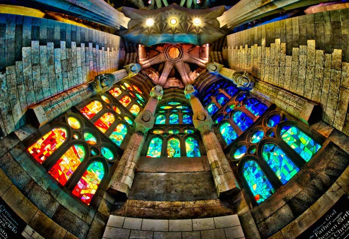 HDR Image looking up into Sagrada Familia's apse and the riot of colors created by the stained glass