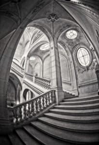 Black and White HDR image of one of the stairways in the Louvre in the style of Escher
